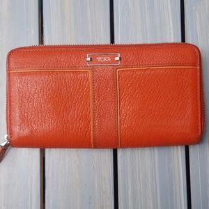 TUMI CHELSEA ORANGE ZIP AROUND CONTINENTAL WALLET